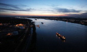 Cargo ships pass along the Mississippi River April 13 2011 in New Orleans Louisiana Shipping lanes were not significantly disrupted in the aftermath...