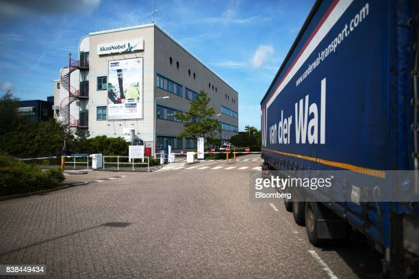 A cargo truck arrives outside the Akzo Nobel NV paint and coatings factory in Sassenheim Netherlands on Thursday Aug 24 2017 Akzo Nobel and activist...