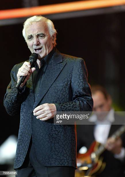 French singer Charles Aznavour performs on the stage of the 'Vieilles Charrues' music festival 19 July 2007 in Carhaix western France AFP PHOTO FRED...