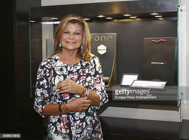 Cari Lapique presents charity bracelet By Suarez in order to raise funds for the Aladina Foundation at Suarez Jewellery shop on December 3 2014 in...
