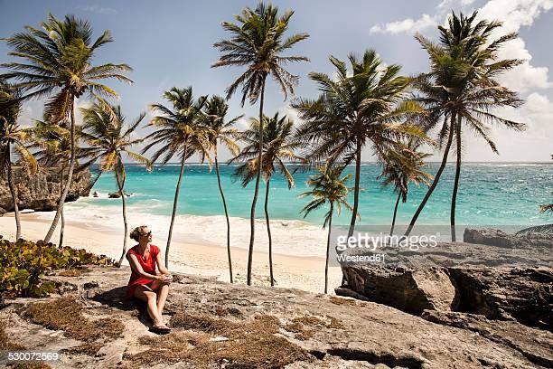 Caribbean, Barbados, Bottom Bay, woman sitting at the coast