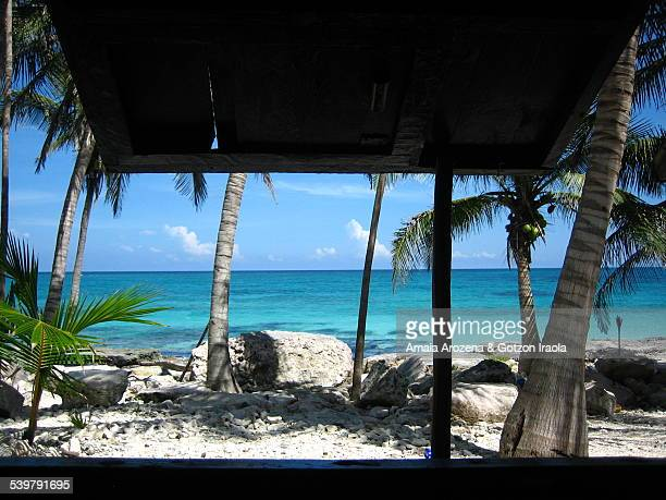 Caribbean coast in Tulum from inside a cabana