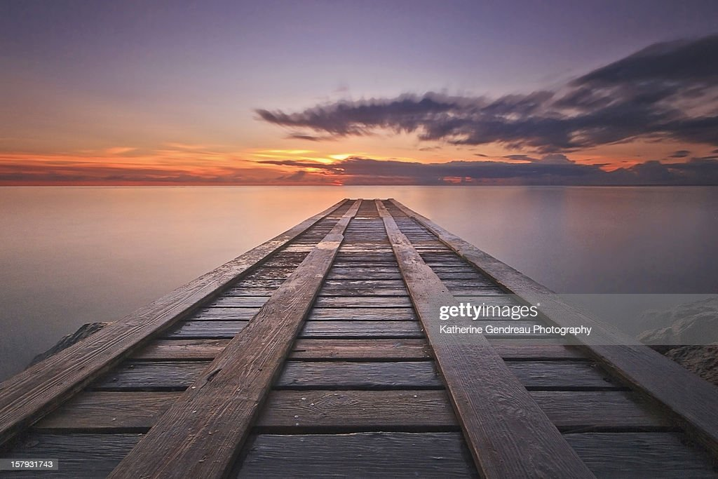 Caribbean fishing dock at sunset : Stock Photo
