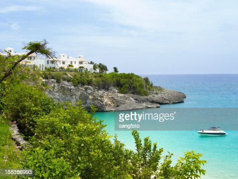 Caribbean island scene with yacht on water
