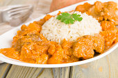 Lamb and sweet potato peanut stew served with white rice. Caribbean and West African traditional dish.