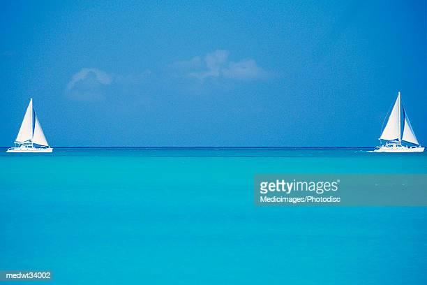 Caribbean, Turks and Caicos Islands, Providenciales, Grace Bay Beach, Sailboats in ocean