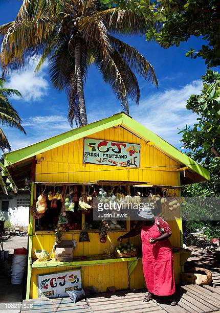 Caribbean women at a  fruit market shot midday