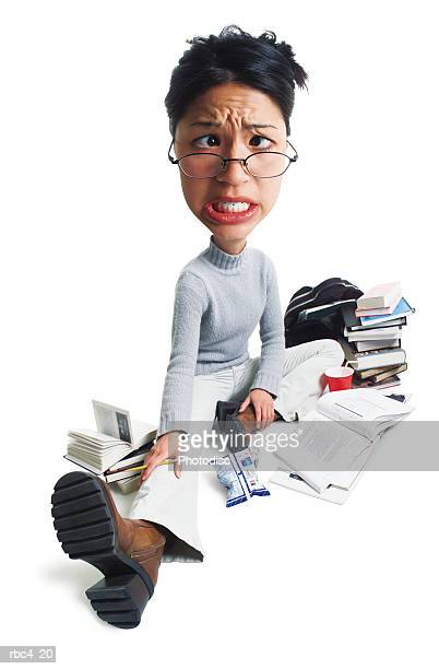 caricature of a young asian female student as she stresses out while studying