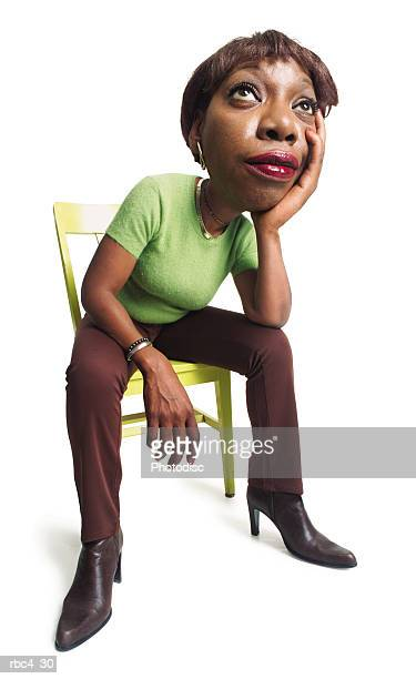 caricature of an african american woman as she sits in a chair and waits with boredom