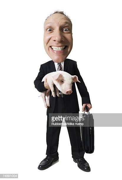 Caricature of businessman holding briefcase and piglet