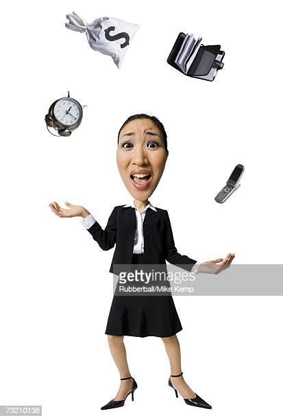 Caricature of businesswoman juggling