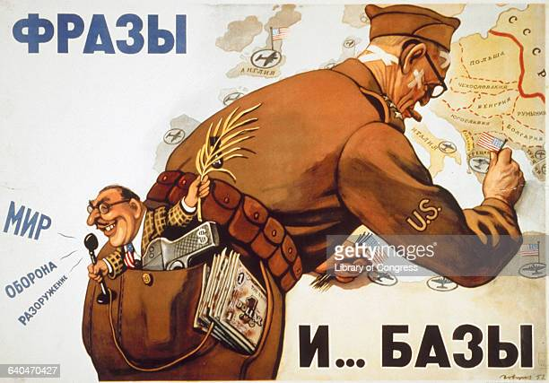 A caricaturefigure of an American soldier pins flags into a map while a small figure representing the USSR sits in his pocket and speaks inot a...