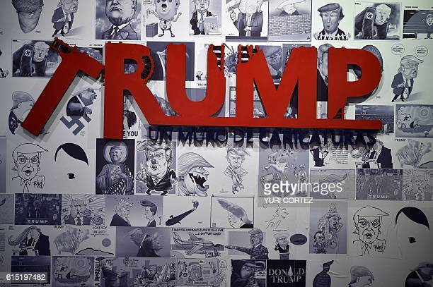 Caricatures depicting US Republican presidential candidate Donald Trump are displayed as part of the exhibition 'A Wall of Caricatures' at the...