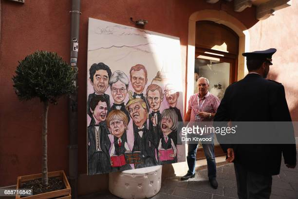 Caricatures of the G7 leaders seen during their summit on May 26 2017 in Taormina Italy