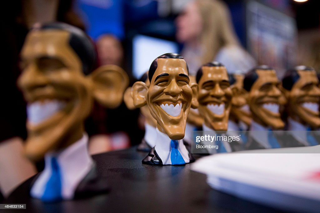 Caricatures of US President Barack Obama sit on display at the Weekly Standard booth on the exhibit floor during the Conservative Political Action...