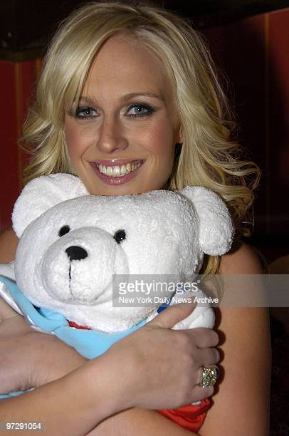CariDee English the winner of the latest installment of the CW television show 'America's Next Top Model' hugs a teddy bear at club Marquee on 10th...