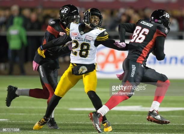 Cariel Brooks of the Hamilton TigerCats misses a touchdownsaving tackle on Juron Criner of the Ottawa Redblacks in Canadian Football League play at...