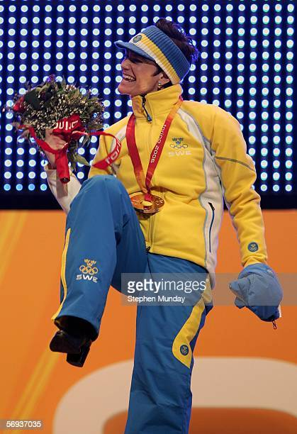 Carin Anna Olofsson of Sweden receives the Gold medal in the Womens Biathlon 125km Mass Start at the Medals Plaza on Day 15 of the 2006 Turin Winter...