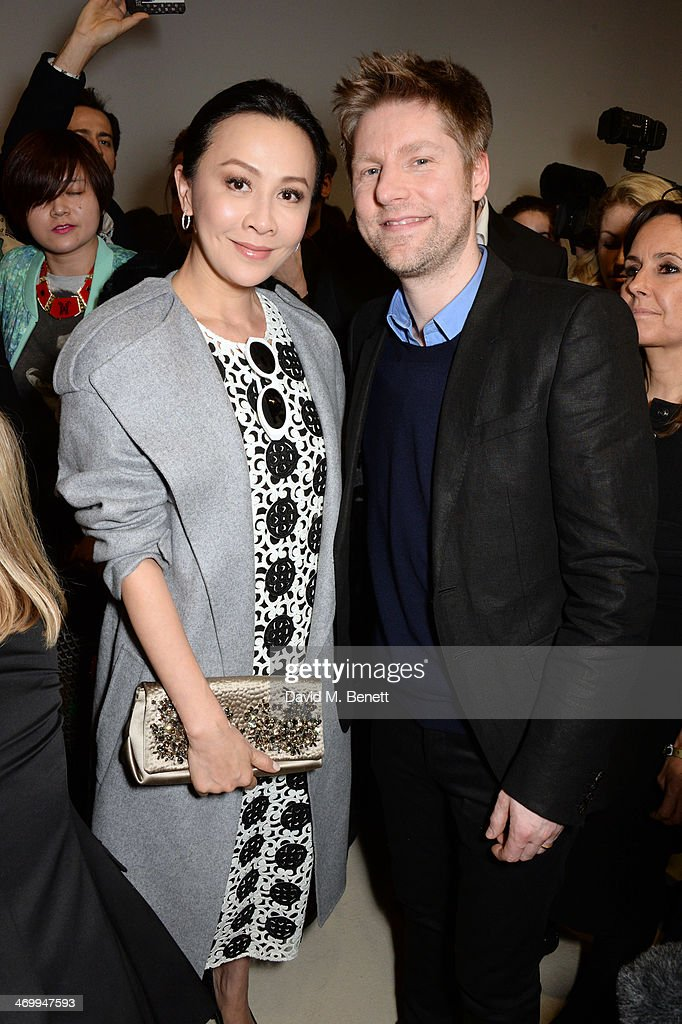 Carina Lau and Christopher Bailey pose backstage after the Burberry Womenswear Autumn/Winter 2014 show at Kensington Gardens on February 17 2014 in...