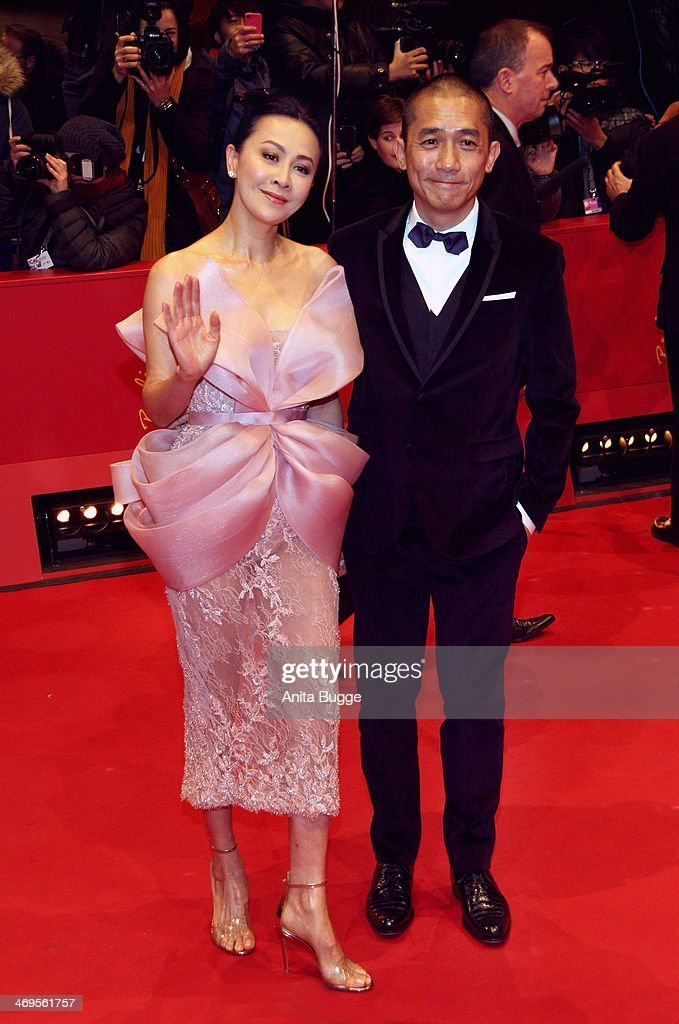 <a gi-track='captionPersonalityLinkClicked' href=/galleries/search?phrase=Carina+Lau&family=editorial&specificpeople=663580 ng-click='$event.stopPropagation()'>Carina Lau</a> and Tony Leung arrive for the closing ceremony during 64th Berlinale International Film Festival at Berlinale Palast on February 15, 2014 in Berlin, Germany.