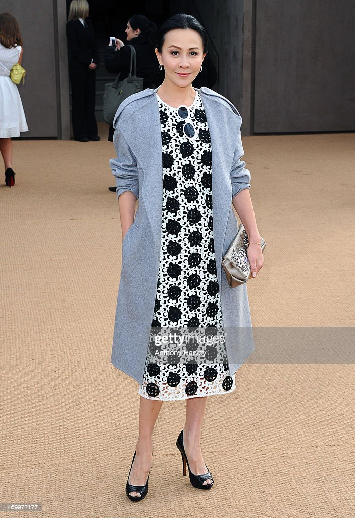 <a gi-track='captionPersonalityLinkClicked' href=/galleries/search?phrase=Carina+Lau&family=editorial&specificpeople=663580 ng-click='$event.stopPropagation()'>Carina Lau</a> attends the Burberry Prorsum show at London Fashion Week AW14 at Kensington Gardens on February 17, 2014 in London, England.