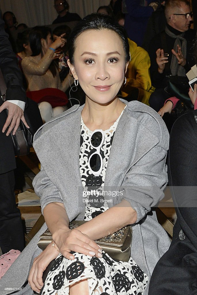 <a gi-track='captionPersonalityLinkClicked' href=/galleries/search?phrase=Carina+Lau&family=editorial&specificpeople=663580 ng-click='$event.stopPropagation()'>Carina Lau</a> attends the front row at Burberry Womenswear Autumn/Winter 2014 at Kensington Gardens on February 17, 2014 in London, England.