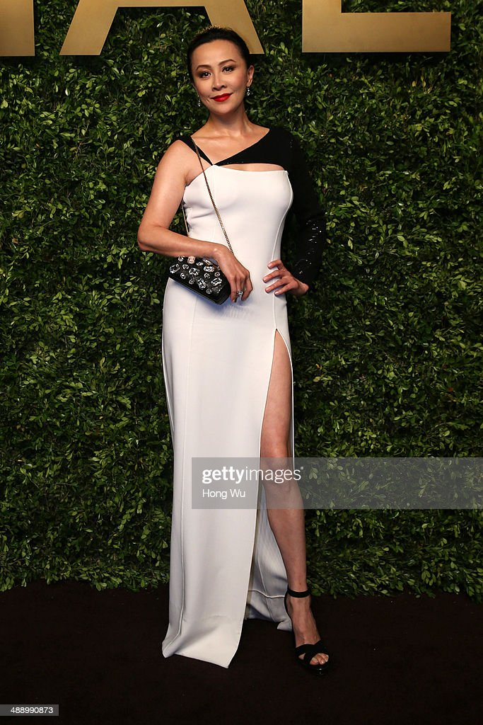<a gi-track='captionPersonalityLinkClicked' href=/galleries/search?phrase=Carina+Lau&family=editorial&specificpeople=663580 ng-click='$event.stopPropagation()'>Carina Lau</a> attends the Michael Kors Jet Set Experience on May 9, 2014 in Shanghai, China.