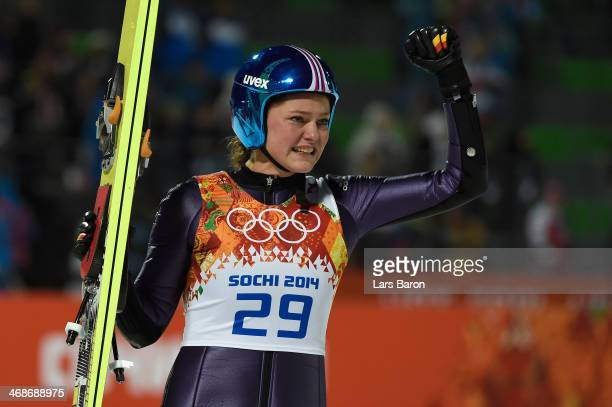 Carina Vogt of Germany celebrates winning the gold medal during the Ladies' Normal Hill Individual final round on day 4 of the Sochi 2014 Winter...