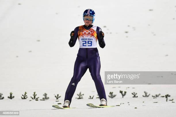 Carina Vogt of Germany reacts after jumping during the Ladies' Normal Hill Individual final round on day 4 of the Sochi 2014 Winter Olympics at the...