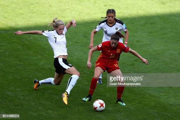 Carina Wenninger of Austria and Laura Feiersinger of Austria attempt to tackle Vicky Losada of Spain during the UEFA Women's Euro 2017 Quarter Final...