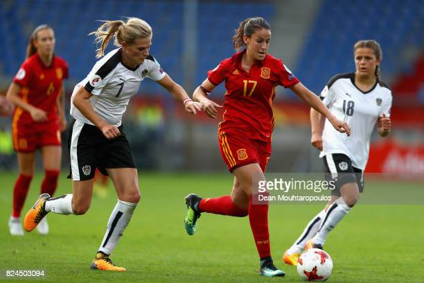 Carina Wenninger of Austria and Olga Garcia of Spain battle for possession during the UEFA Women's Euro 2017 Quarter Final match between Austria and...