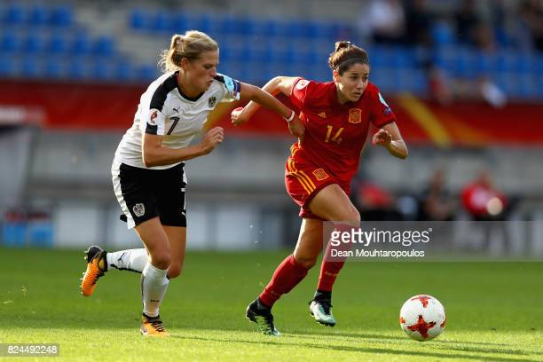 Carina Wenninger of Austria and Vicky Losada of Spain battle for possession during the UEFA Women's Euro 2017 Quarter Final match between Austria and...