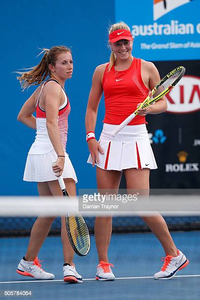 Carina Witthoeft of Germany and Annika Beck talk tactics in their first round match against AnnaLena Groenefeld of Germany and Coco Vandeweghe of the...
