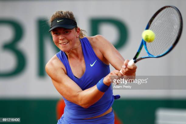 Carina Witthoeft of Germany hits a backhand during the ladies singles second round match against Pauline Parmentier of France on day five of the 2017...