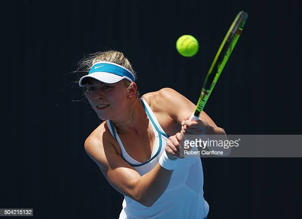 Carina Witthoeft of Germany plays a backhand in the women's singles match against Alison Van Uytvanck of Belgium during day one of 2016 Hobart...