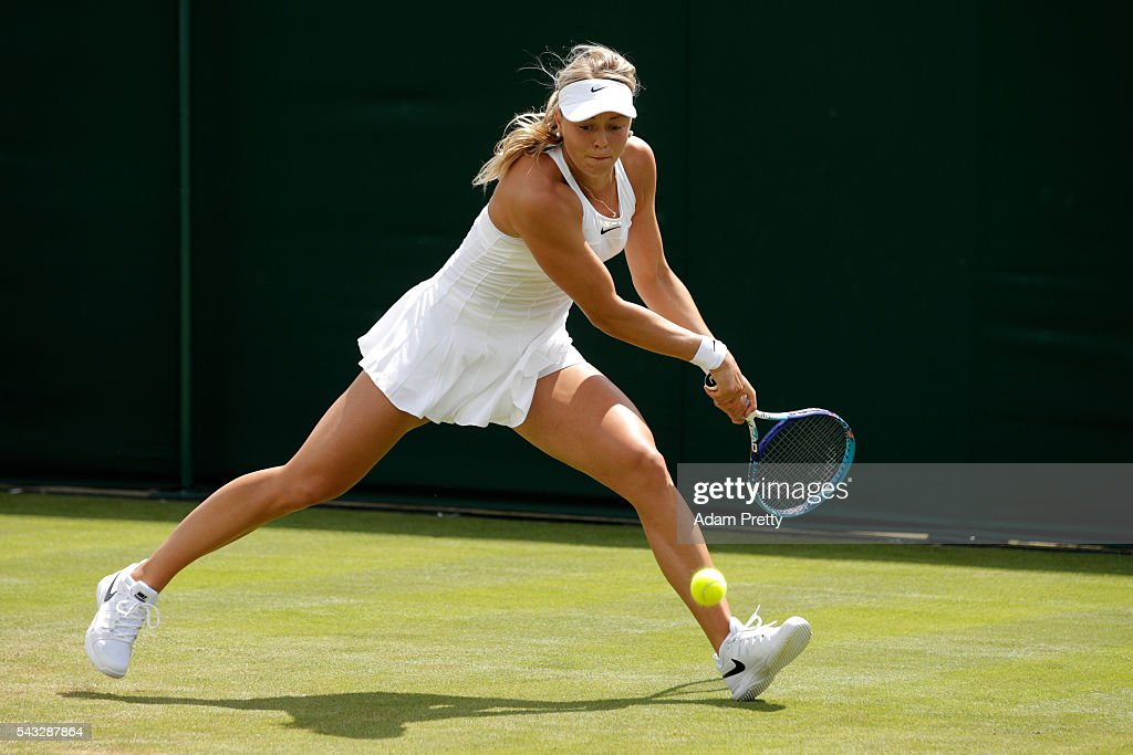 Carina Witthoeft of Germany plays a backhand shot during the Ladies Singles first round match against Irina-Camelia Begu of Romania on day one of the Wimbledon Lawn Tennis Championships at the All England Lawn Tennis and Croquet Club on June 27th, 2016 in London, England.