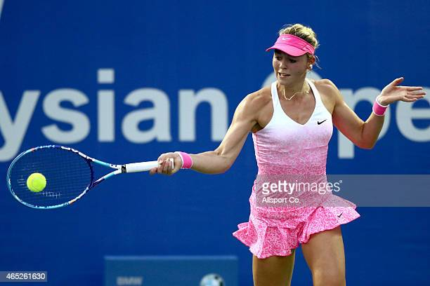 Carina Witthoeft of Germany plays a shot against Klara Koukalova of the Czech Republic during day four of the BMW Malaysian Open at The Royal...