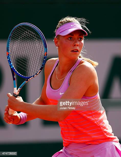 Carina Witthoeft of Germany plays a shot during her women's singles match against Katerina Siniakova of Czech Republic on day two of the 2015 French...