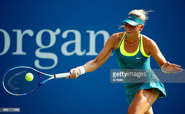 Carina Witthoeft of Germany retruns a shot against Garbine Muguruza of Spain during their Women's Singles First Round match on Day Two of the 2015 US...