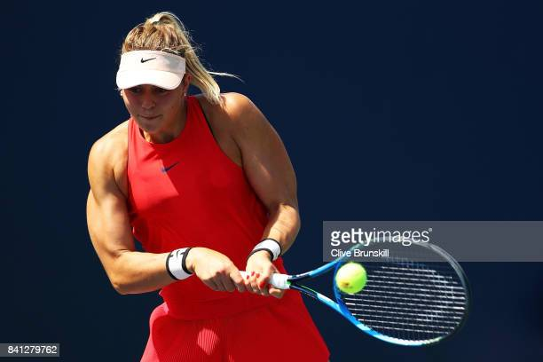 Carina Witthoeft of Germany returns a shot against Naomi Broady of Great Britain and Darija Jurak of Croatia during their first round Women's Doubles...