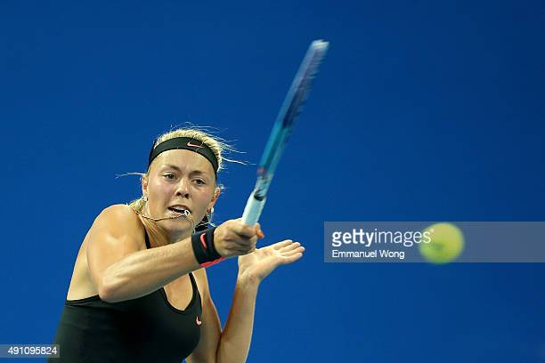 Carina Witthoeft of Germany returns a shot against Svetlana Kuznetsova of Russia during the day one of the 2015 China Open at the China National...