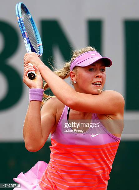 Carina Witthoeft of Germany returns a shot during her Women's Singles match against Sara Errani of Italy on day five of the 2015 French Open at...