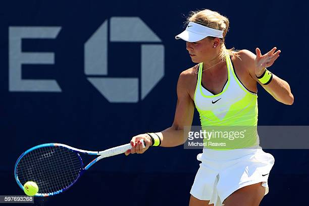 Carina Witthoeft of Germany returns a shot to during her first round Women's Singles match against Misaki Doi of Japan on Day One of the 2016 US Open...