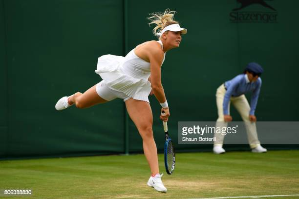 Carina Witthoeft of Germany serves during the Ladies Singles first round match against Mirjana LucicBaroni of Croatia on day one of the Wimbledon...