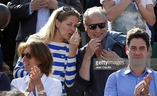 Carine Galli and Hippolyte Girardot attend day 11 of the French Open 2015 at Roland Garros stadium on June 3 2015 in Paris France