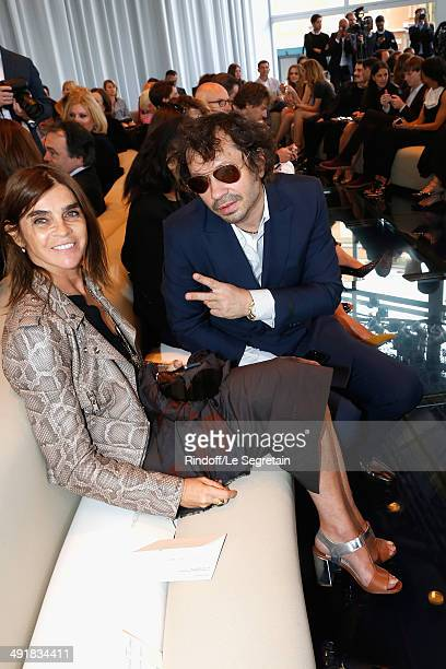 Carine Roitfeld and a guest attend the Louis Vuitton Cruise Line Show 2015 at Palais Princier on May 17 2014 in MonteCarlo Monaco