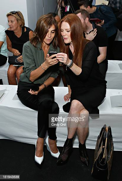 Carine Roitfeld and actress Julianne Moore attends the Reed Krakoff spring 2013 fashion show during MercedesBenz Fashion Week at Skylight West on...