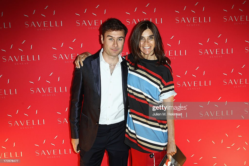 Carine Roitfeld and Alessandro Savelli attend the Founder And CEO Alessandro Savelli And Contemporary Style Icon Julia Restoin Roitfeld Launch SAVELLI The World's First Luxury Smart Phone Especially For Women During Haute Couture Week at Musee Jacquemart-Andre on July 3, 2013 in Paris, France.