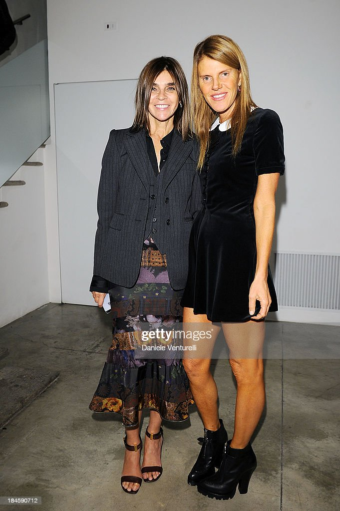 <a gi-track='captionPersonalityLinkClicked' href=/galleries/search?phrase=Carine+Roitfeld&family=editorial&specificpeople=240177 ng-click='$event.stopPropagation()'>Carine Roitfeld</a> and <a gi-track='captionPersonalityLinkClicked' href=/galleries/search?phrase=Anna+Dello+Russo&family=editorial&specificpeople=4391772 ng-click='$event.stopPropagation()'>Anna Dello Russo</a> attends Cardi Black Box Gallery Present Nicolas Pol hosted by Nicolo Cardi And Vladimir Restoin Roitfeld at Cardi Black Box on October 14, 2013 in Milan, Italy.