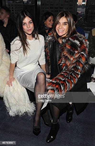 Carine Roitfeld and daughter Julia Roitfeld attend the Altuzarra fashion show during MercedesBenz Fashion Week Fall 2014 at Spring Studios on...